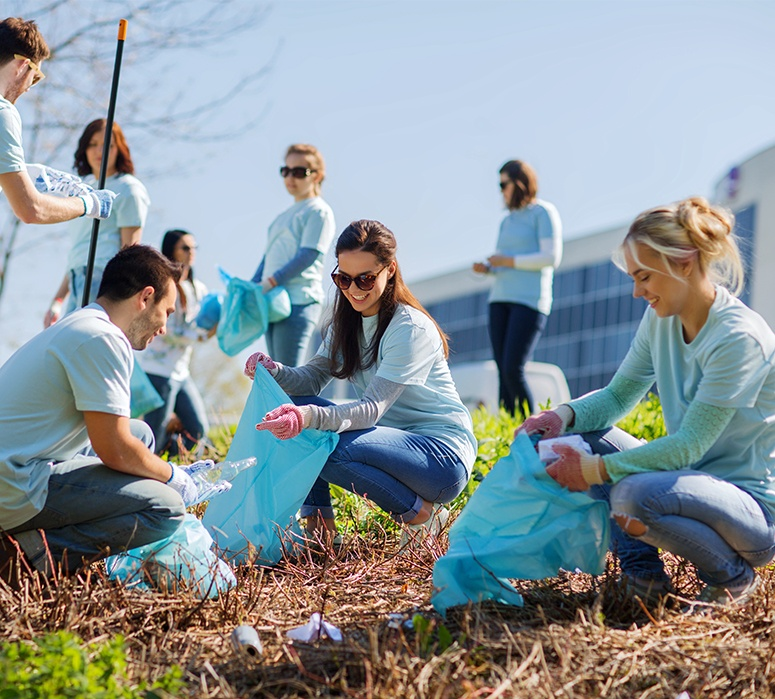 Dental team members participating in community cleanup event