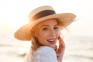 Woman enjoying the summer sun for a healthy smile
